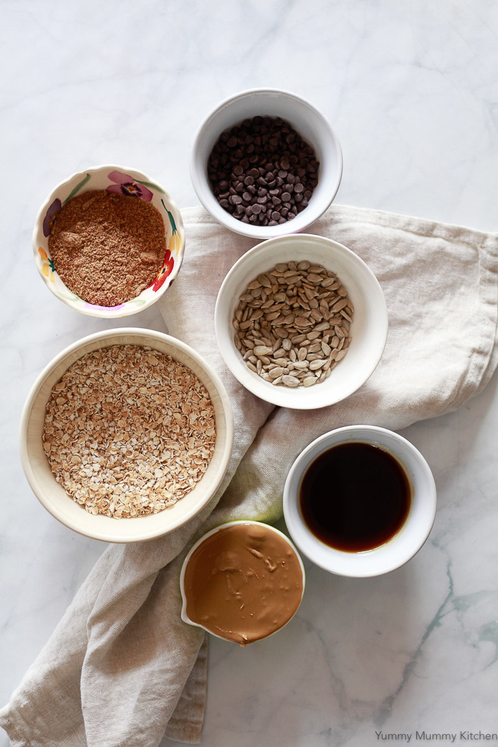 Ingredients for no-bake energy balls include oats, flax meal, sunflower seed butter, and maple syrup.