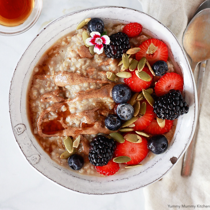 A bowl of steel cut oats made from scratch is so simple when you use a slow cooker or Instant Pot! Top with your favorite berries, seeds, or nuts for a warm and wholesome breakfast.