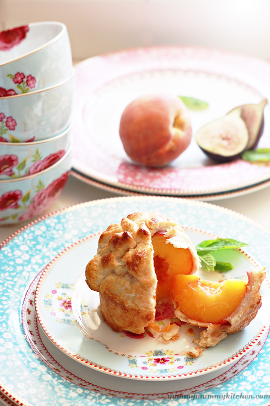 Whole peach wrapped in pastry dough to make individual whole peach pies!
