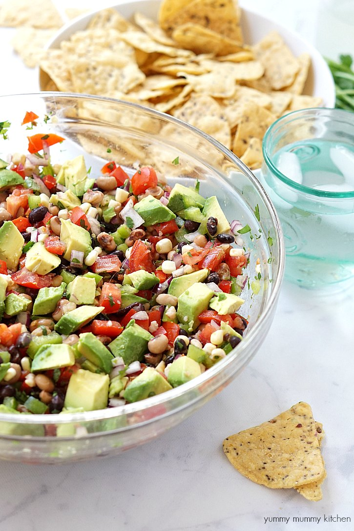 A big bowl of cowboy caviar salsa served with tortilla chips is the best game day appetizer!