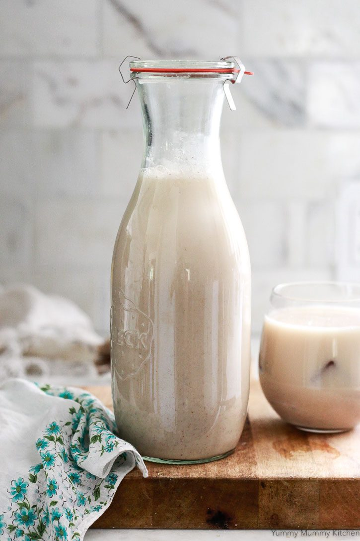 A Weck carafe filled with homemade horchata in a white kitchen.