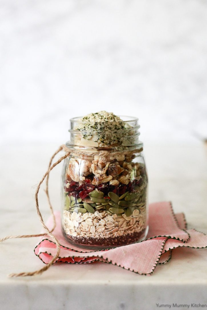 This beautiful jar layered with muesli ingredients like oats, seeds, and dried fruit is a great healthy DIY edible gift idea.