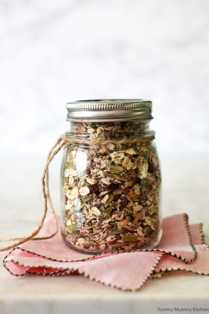 A jar of mixed Bircher muesli ready to be soaked overnight, or eaten hot or cold for a healthy vegan breakfast.