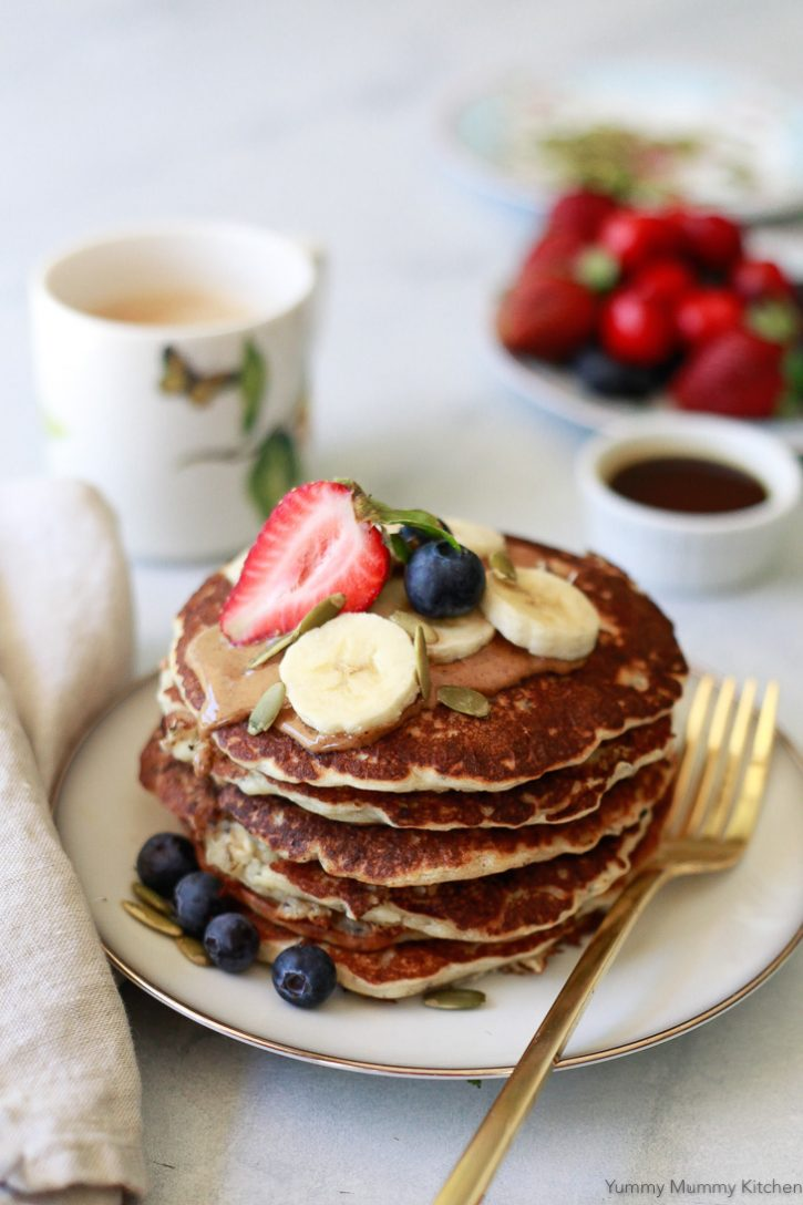 Beautiful vegan banana pancakes topped with berries and bananas. This easy vegan banana pancake recipe is such a delicious breakfast.