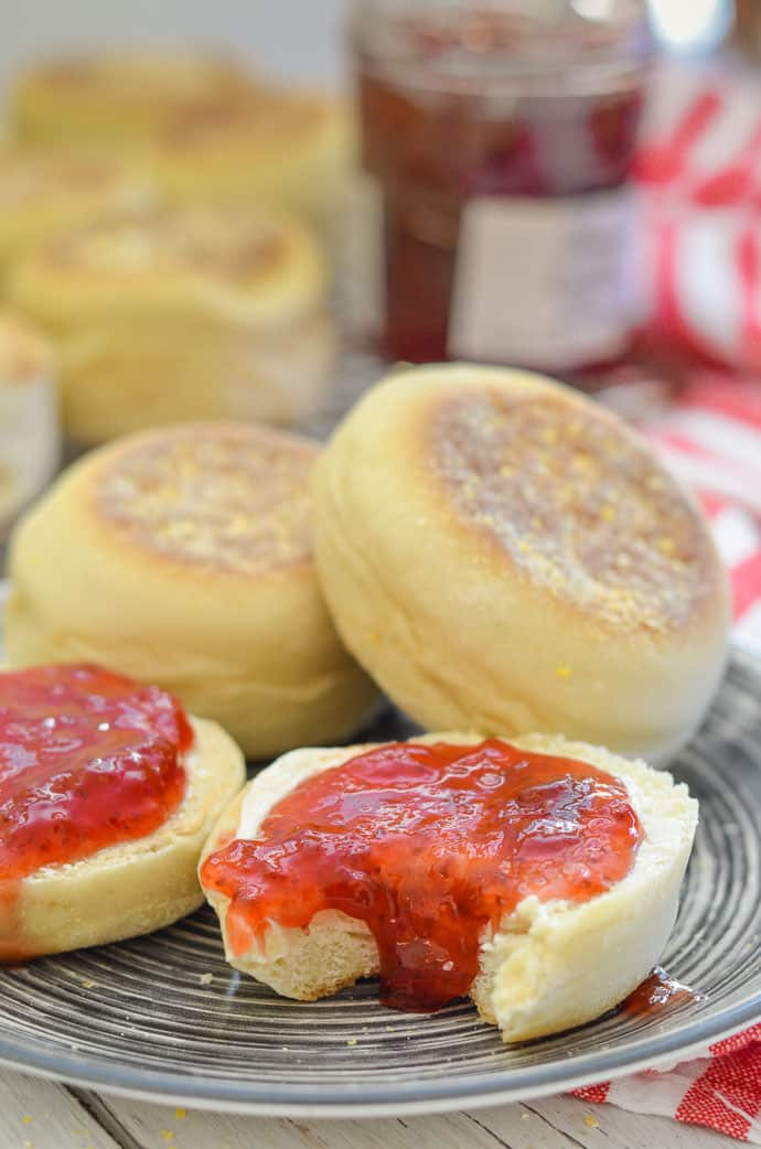 Fluffy homemade english muffins with jam.