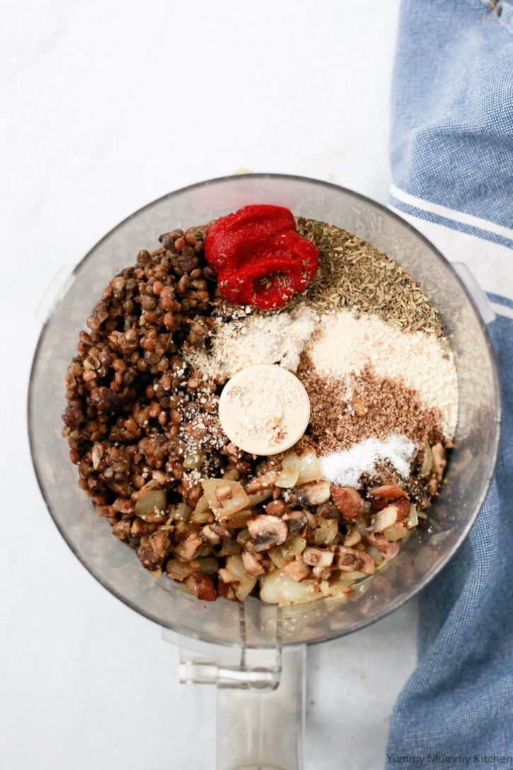 Lentils, mushrooms, walnuts, Italian spices, tomato paste, and bread crumbs in a food processor to make vegan lentil meatballs.