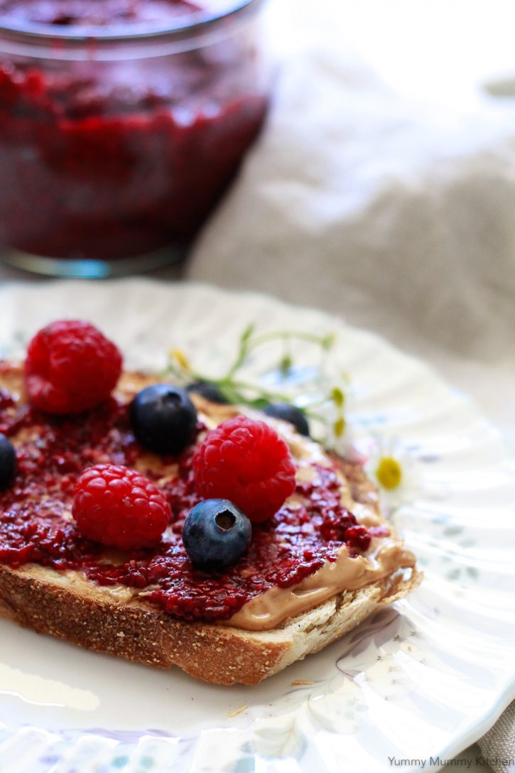 Blueberry and raspberry chia jam on toast with peanut butter. This beautiful chia jam recipe is so easy to make with fresh or frozen berries and has no added sugar.