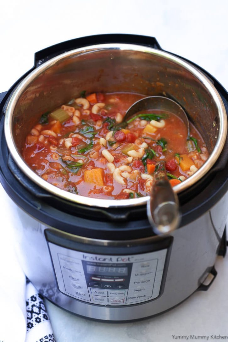 An Instant Pot pressure cooker filled with a vegan Minestrone soup.