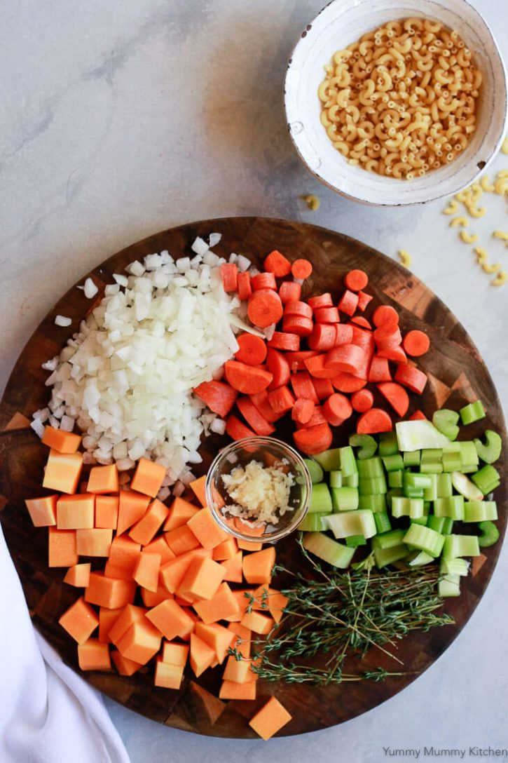 The ingredients for Instant Pot Minestrone Soup on a cutting board.