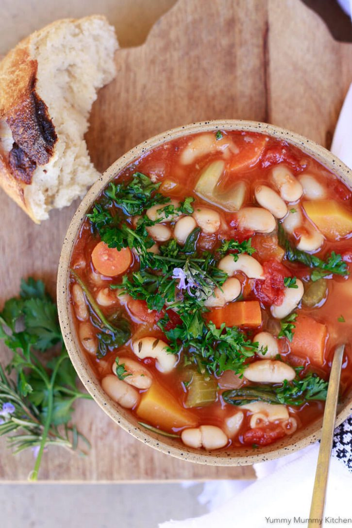 A bowl of vegan Minestrone soup with white beans and vegetables is perfect for healthy meal prep day.