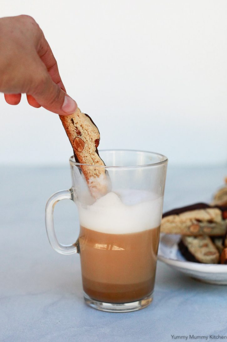 A homemade almond biscotti gets dipped into a hazelnut latte.