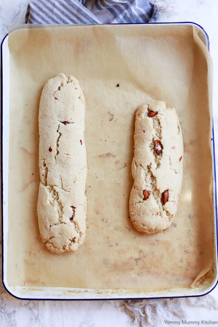 Biscotti logs on a cookie sheet after the fist baking.