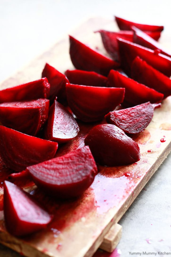 Cooked red beets have been sliced into wedges for a beet salad recipe.
