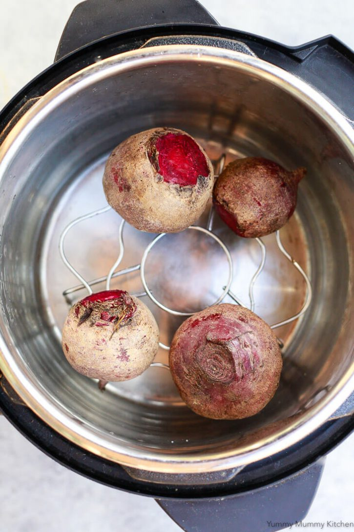 Raw beets on a steamer in an Instant Pot pressure cooker. How to cook beets in the Instant Pot.