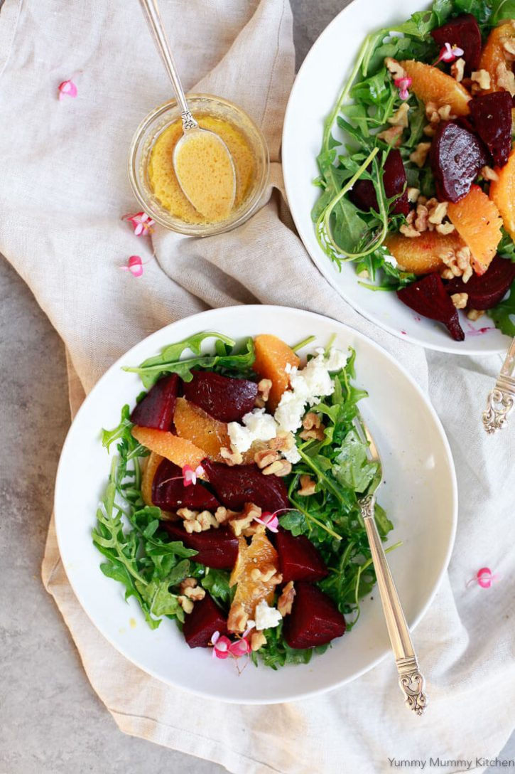 Beet salad with arugula, goat cheese, walnuts and a homemade orange beet dressing. This healthy winter beet salad is easy to make vegan and gluten free!