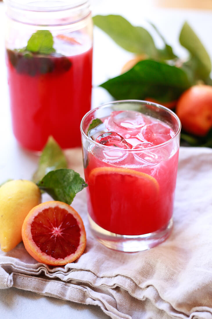 A healthy low-sugar blood orange lemonade recipe. Winter pink lemonade made with blood oranges and fresh lemons is a pretty, refreshing, and tasty non-alcoholic beverage.