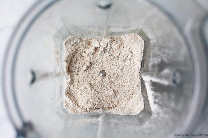 Homemade oat flour in the bottom of a Vitamix blender. Oat flour is great for gluten free baking.