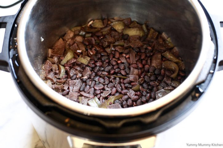 Cuban black beans in an Instant Pot pressure cooker after pressure cooking.