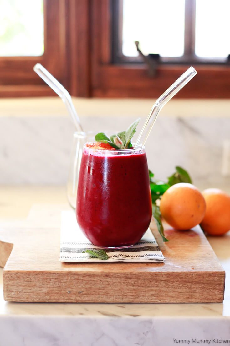 Delicious beet smoothie recipe with orange and berries. This easy smoothie made with raw beets is high in Vitamin-C, antioxidants, and is anti inflammatory. Enjoy this beet smoothie for breakfast topped with yogurt and granola or as an energy-boosting afternoon snack.