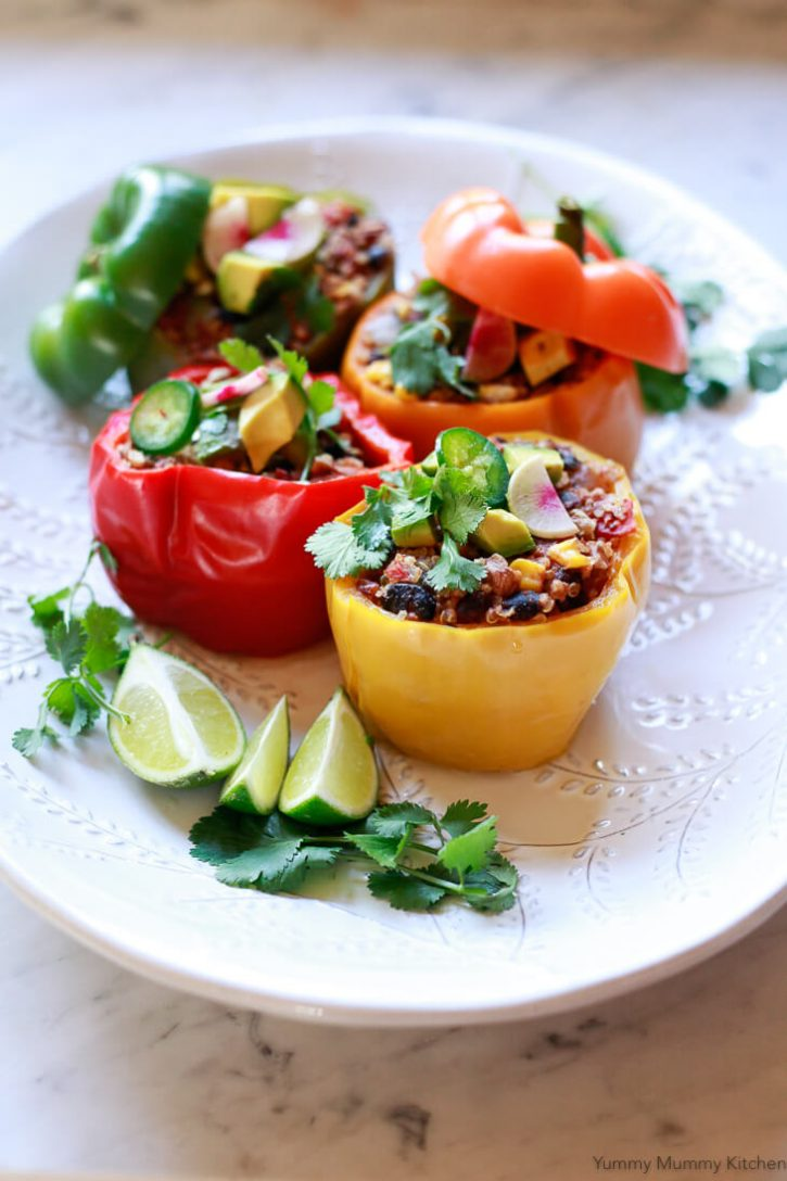Colorful quinoa and bean stuffed bell peppers are a beautiful healthy vegan, vegetarian dinner.