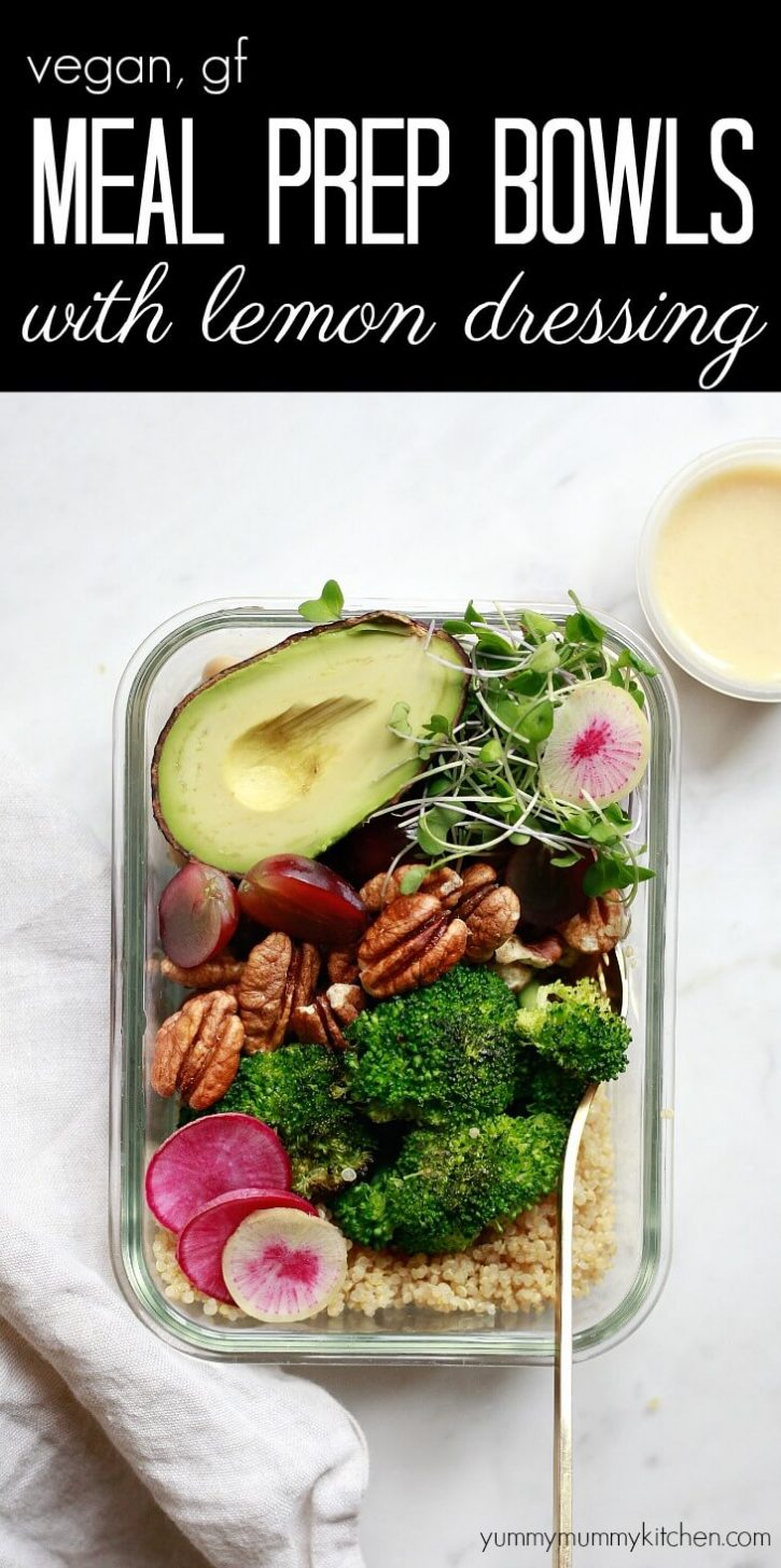 A glass meal prep container filled with quinoa, chickpeas, roasted broccoli, pecans, grapes, microgreens, and half an avocado. A small container of lemon dressing sits on the side for dressing this vegan, vegetarian, gluten-free, meal prep bowl.