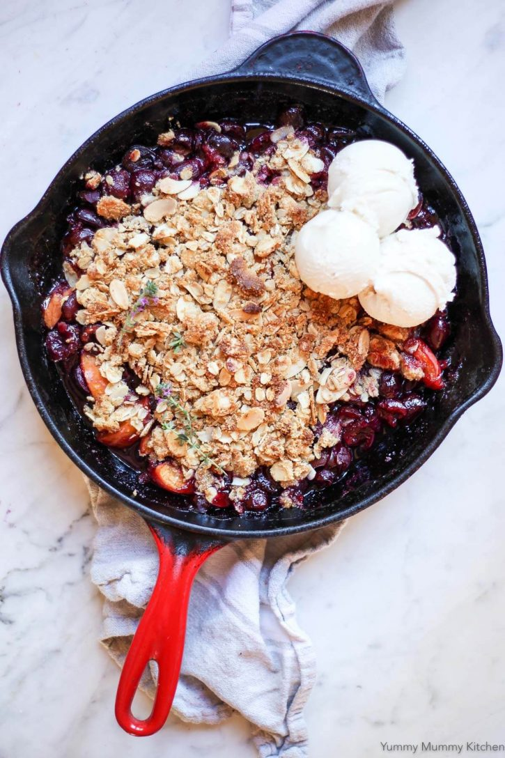 A cherry crisp made with fresh summer cherries and apricots and topped with gluten free almond flour crumble. A delicious healthy summer fruit crisp dessert.