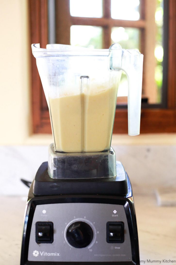 A creamy pineapple banana smoothie in a Vitamix blender.