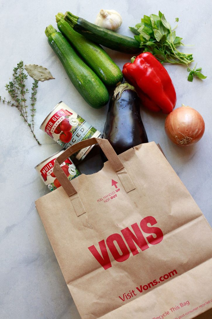 Ingredients for ratatouille coming out of a grocery bag.