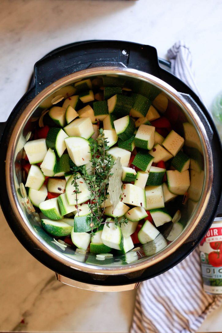 The ingredients for rustic ratatouille are layered in an Instant Pot pressure cooker.