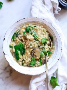 A white bowl filled with mushroom risotto.