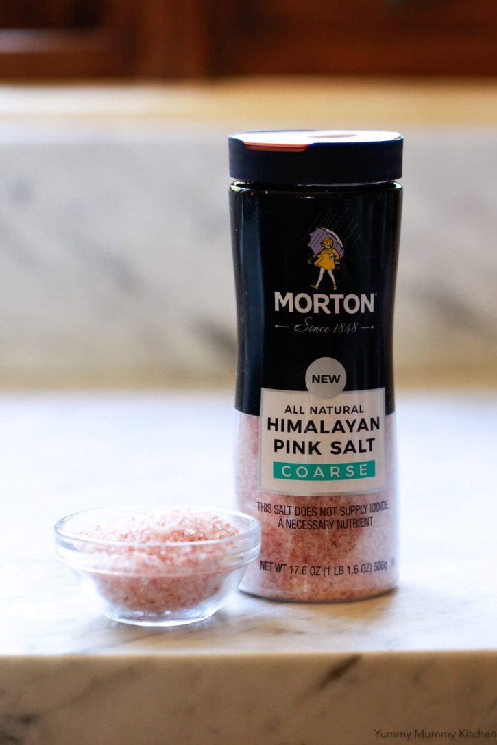 Morton Himalayan pink salt on a white marble counter.