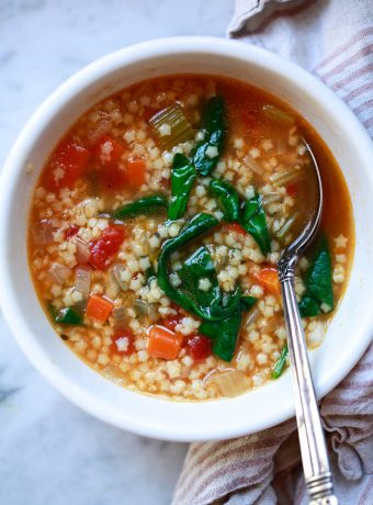 A bowl of Italian pastina soup with stars.